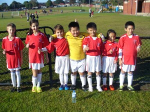 Singo's Heroes. Our U/9 Green team poses for the camera after a gruelling game at George Green.
