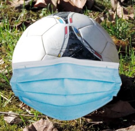 Soccer ball with a medical mask on it